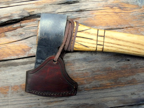 custom colonial axe with a leather sheath.
