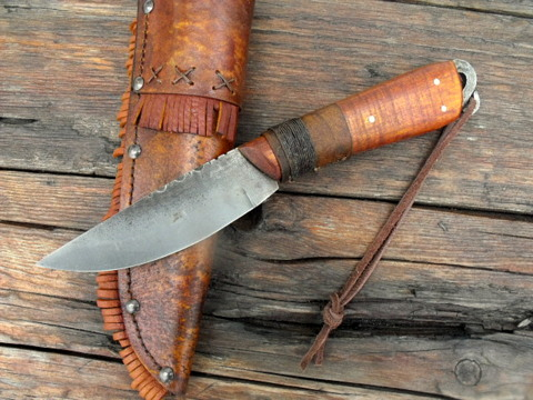 roach belly knife with a forged lanyard