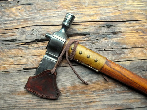 pipe axe with a leather sheath