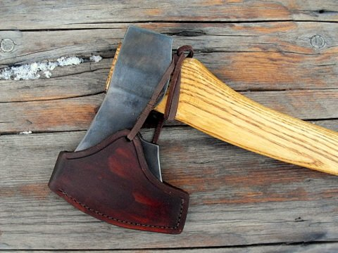 hand-forged custom axe with leather sheath