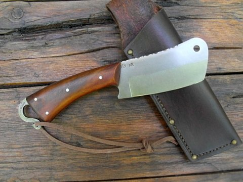 custom forged camp cleaver with a leather sheath